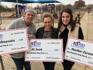 Kasey Benavides, Ali Smith and Heather Carson posting with check from Education Foundation
