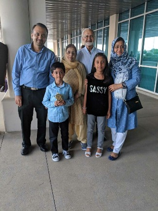 Taha with his family